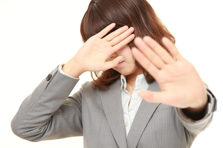 woman stop: young Japanese businesswoman making stop gesture