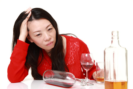 drunkenness: Japanese woman in depression is drinking alcohol