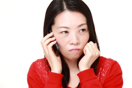 bad news: Japanese woman receiving bad news Stock Photo