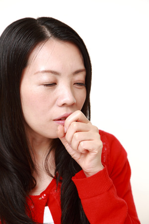 coughing: Japanese woman coughing Stock Photo
