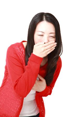 vomito: Mujer japonesa se siente como v�mitos Foto de archivo