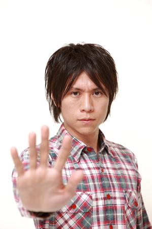 stop gesture: young Japanese man making stop gesture