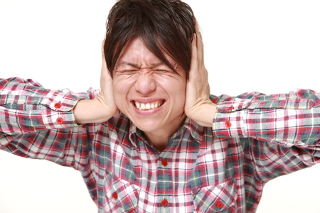 suffers: Young Japanese man suffers from noise