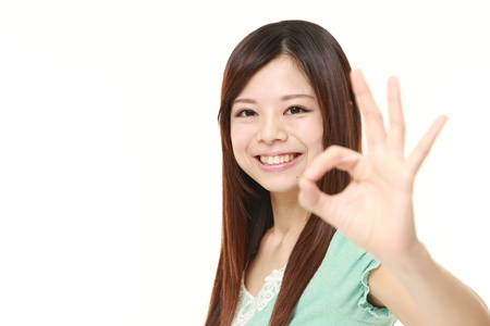 perfect sign: young Japanese woman showing perfect sign Stock Photo