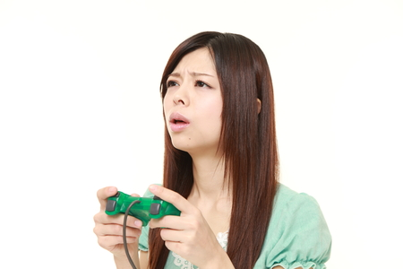 losing control: young Japanese woman losing playing video game