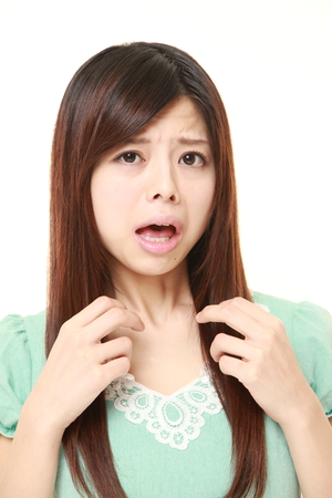 baffled: young Japanese woman shocked Stock Photo