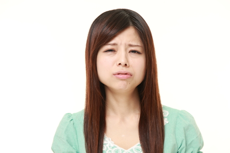 perplexed: perplexed young Japanese woman