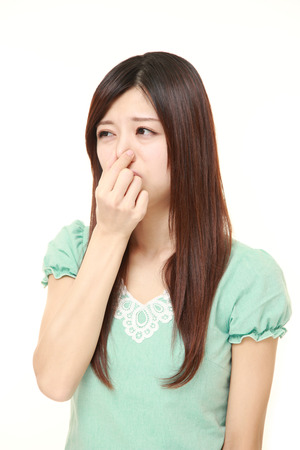 bad smell: Japanese woman holding her nose because of a bad smell Stock Photo