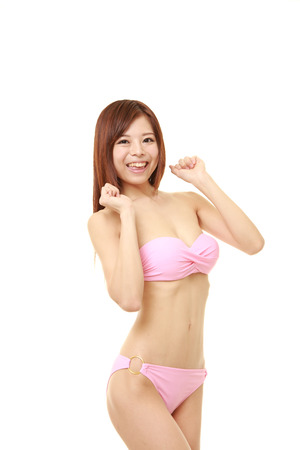 debauch: young Japanese woman in a pink bikini pleased Stock Photo