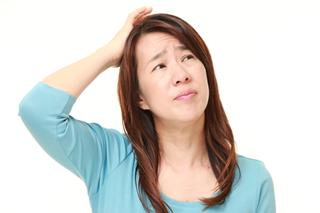 baffled: Japanese woman worries about something Stock Photo