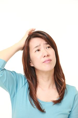 baffled: perplexed Japanese woman Stock Photo