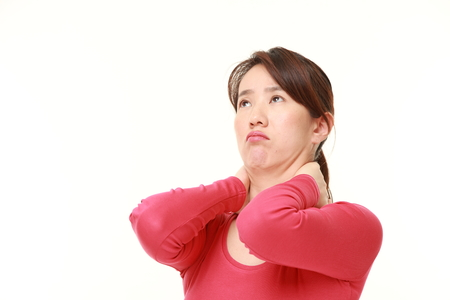 Japanese woman suffers from neck ache Stock fotó
