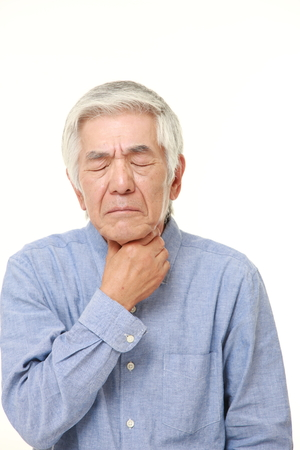 senior man on a neck pain: senior Japanese man having throat pain