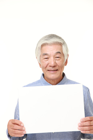 message board: senior Japanese man with message board