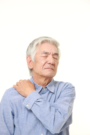 suffers: senior Japanese man suffers from neck ache