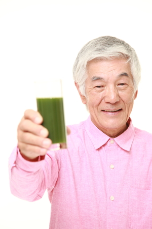 70s adult: senior Japanese man with green vegetable juice