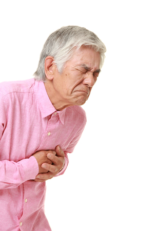 seniors suffering painful illness: senior Japanese man heart attack