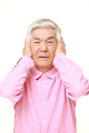 suffers: senior Japanese man suffers from noise