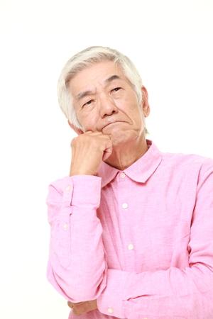 senior Japanese man worries about something Stock Photo
