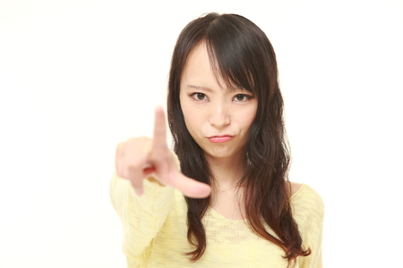 scolding: young Japanese woman scolding Stock Photo