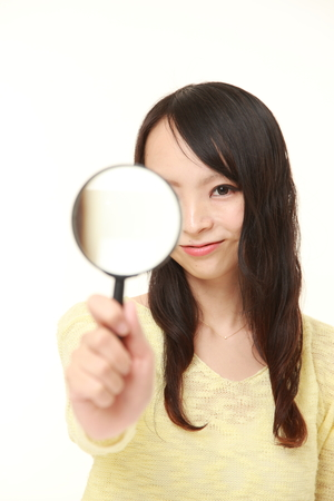 Japanese woman with a magnifying glass