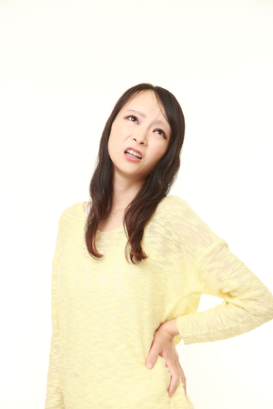lumbago: Japanese woman suffers from lumbago Stock Photo