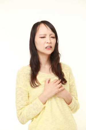 seniors suffering painful illness: young Japanese woman heart attack