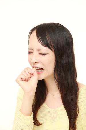 coughing: young Japanese woman coughing Stock Photo