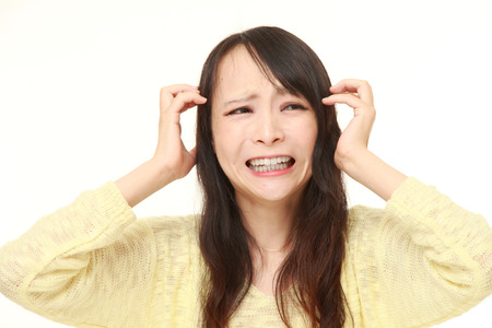 young Japanese woman shocked Stock Photo