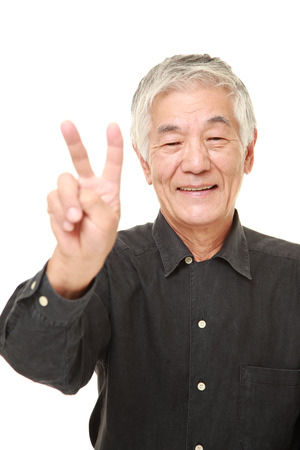 hand sign: senior Japanese man showing a victory sign Stock Photo