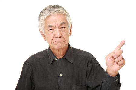 old black man: senior Japanese man doubting