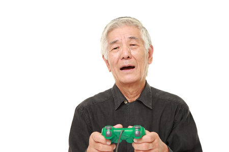 wimp: senior Japanese man losing playing video game