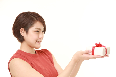 parting: young Japanese woman offering a gift