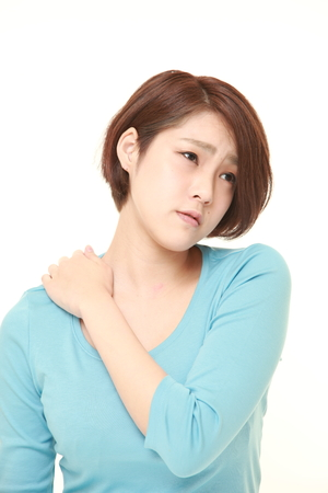 young Japanese woman suffers from neck ache