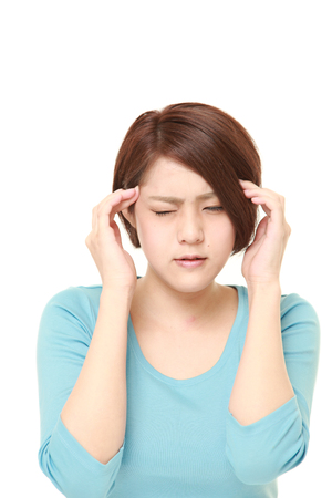 suffers: young Japanese woman suffers from headache