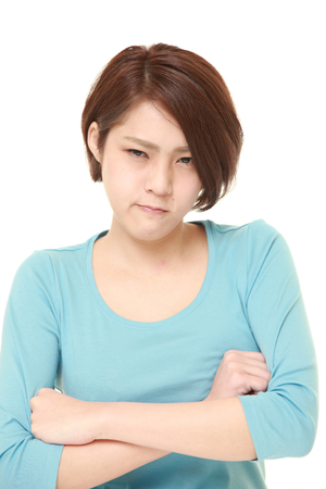 bad mood: young Japanese woman in a bad mood Stock Photo