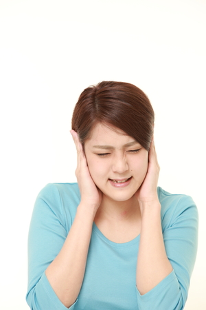 bad hair: Young Japanese woman suffers from noise