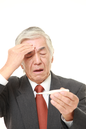 light complexion: senior Japanese businessman with fever