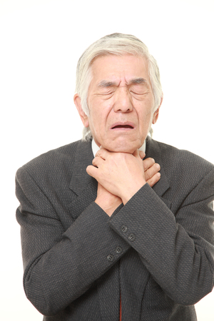 senior man on a neck pain: senior Japanese businessman having throat pain