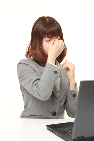suffers: young Japanese businesswoman suffers from Asthenopia Stock Photo