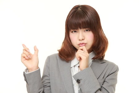 nonchalant: young Japanese businesswoman doubting