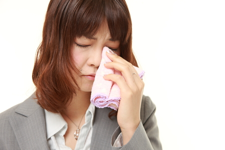 cries: young Japanese businesswoman cries