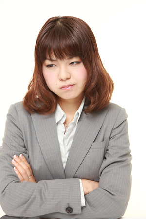 bad mood: young Japanese businesswoman in a bad mood Stock Photo