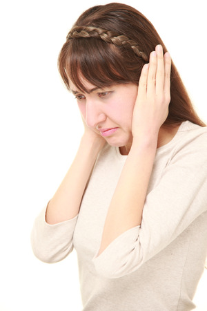 suffers: Young woman suffers from noise