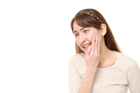 suffers: young woman suffers from toothache Stock Photo