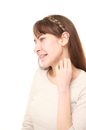 scratching: young woman scratching her neck