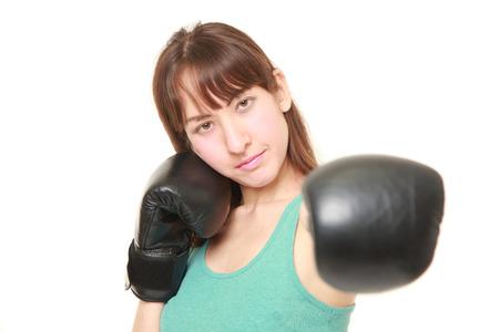 jab: female boxer throwing a left jab