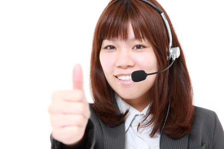 businesswoman with thumbs up gesture 写真素材