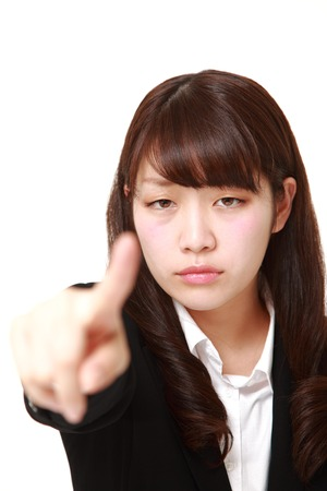 denunciation: young Japanese businesswoman scolding  ?