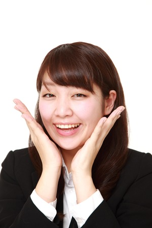 pleased: young Japanese businesswoman pleased